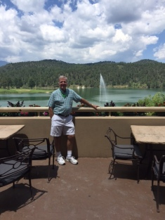 Les enjoying the patio at the Inn of the Mountain Gods. Lake and golf course in the background.