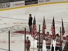 Singing the National Anthem on Military Appreciation Day during a local hockey game