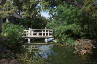 Bridge over one of the many ponds at the Chandor Gardens